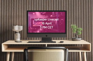 Desk with monitor showing upKeeper livecast info